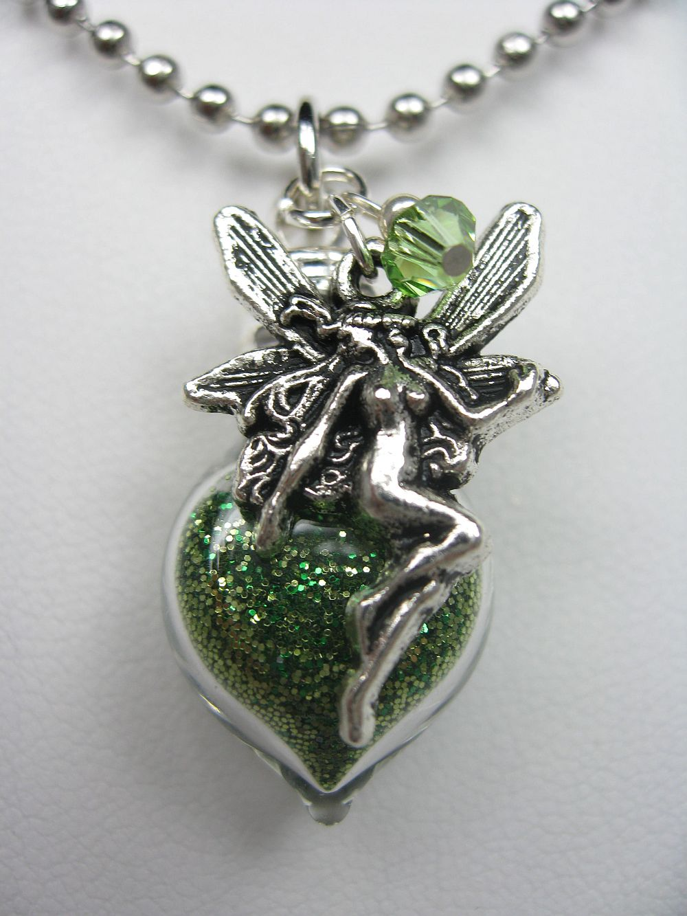 green pixie dust necklace with charm